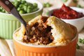 Tasty Australian meat pie in a pot on the table macro Royalty Free Stock Photo