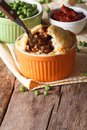 Tasty Australian meat pie in a pot on the table. vertical Royalty Free Stock Photo