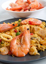 Tasty authentic spanish paella close up with whole prawns Royalty Free Stock Images