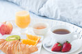 Tasty breakfast in bed Stock Photos