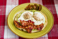 Tasty breakfast guacamole bacon and fried eggs Stock Images