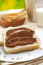 Tasty breakfast made of bread with chocolate cream Royalty Free Stock Image