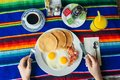 Tasty breakfast with pancakes, fried eggs and bacon on table Royalty Free Stock Photo