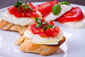 Tasty bruschetta on white plate Stock Photos