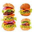 Tasty burgers three hamburgers isolated on white Royalty Free Stock Image