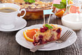 Tasty cake with orange apple and cranberries on a plate Royalty Free Stock Image