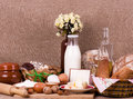 Tasty cakes in basket, eggs, glass of milk Royalty Free Stock Images