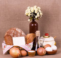 Tasty cakes and bread in basket,  olive oil, eggs Royalty Free Stock Photography