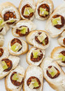 Tasty canapes with butter, sausage, cheese and paprika, refreshm Royalty Free Stock Photo