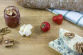 Tasty cheese roquefort and brie, bread, jam, nuts
