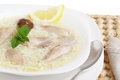 Tasty chicken soup on a table isolated white Royalty Free Stock Image
