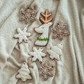 Tasty Christmas cookies on white plaid