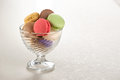 Tasty colorful macaroon in a glass bowl Stock Image