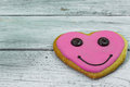 Tasty cookies in the shape of a heart on wooden background Royalty Free Stock Photo