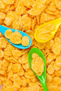 Tasty cornflakes in plastic spoons Stock Photo