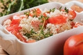 Tasty couscous with herbs ant fresh tomato and healthy mediterranean food Stock Images