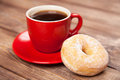 Tasty donut with a cup of coffee Royalty Free Stock Photo