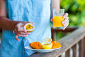 Tasty exotic fruits - ripe passion fruit, mango on breakfast in female hand Royalty Free Stock Photo