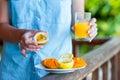 Tasty exotic fruits - ripe passion fruit, mango on breakfast in female hand Royalty Free Stock Photo