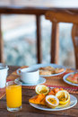 Tasty exotic fruits - ripe passion fruit, mango on breakfast at outdoor restaraunt Royalty Free Stock Photo