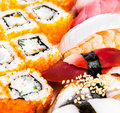 Tasty food sushi and sushi roll sea food on a white background Royalty Free Stock Image