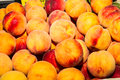 Tasty fresh juicy peaches delicious on sale at local fruit market Stock Photo
