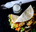 Tasty fresh wrap sandwich with meat, vegetables and cheese, deli Royalty Free Stock Photo
