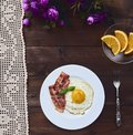 Tastu fried egg in plate with bacon Royalty Free Stock Photo