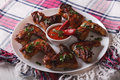 Tasty grilled chicken wings with chili peppers close-up. horizon Royalty Free Stock Photo