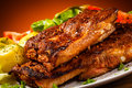 Tasty grilled ribs with vegetables Stock Photo