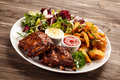 Tasty grilled ribs with vegetables Stock Photography