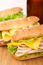 Tasty ham, salami, turkey and beef sandwiches Royalty Free Stock Photo