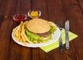 Tasty hamburger on plate Royalty Free Stock Photo