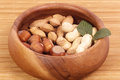 Tasty hazelnuts on a wooden bowl Stock Images
