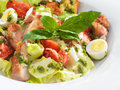 Tasty healthy caesar salad with sweet basil and lettuce on a round plate Stock Photography