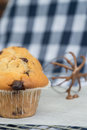 Tasty home made muffins with whisk covered in melting chocolate chip on Stock Photo