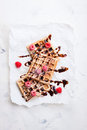 Tasty homemade waffles with raspberries and chocolate sauce ready for breakfast Royalty Free Stock Photo