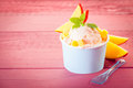 Tasty italian ice cream with fresh apple sliced garnished a sprig of peppermint on pink boards copyspace Stock Images