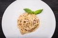 Tasty italian pasta with basil Royalty Free Stock Photo