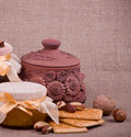 Tasty jam, cupcakes, clay pot and nuts Royalty Free Stock Images