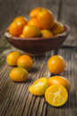 Tasty kumquats on a wooden top sliced kumqaut and ful fruits table Stock Photo