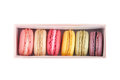 Tasty macaroons in a box colorful french dessert isolate on white vertical view Stock Photos