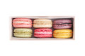 Tasty macaroons in a box colorful french dessert isolate on white vertical view Stock Photo