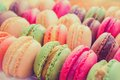 Tasty macaroons colourful in a row Royalty Free Stock Images