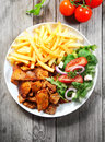 Tasty Main Dish with Steak, Fries and Veggies Royalty Free Stock Photo