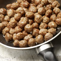 Tasty meatballs beeing prepared in a frying pan fresh Royalty Free Stock Photography