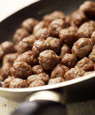 Tasty meatballs beeing prepared in a frying pan fresh Royalty Free Stock Photo