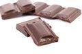 Tasty morsel of dark chocolate white background Stock Photo