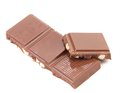 Tasty morsel of milk chocolate with nuts. Royalty Free Stock Photography