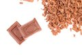 Tasty morsel and slices of choclate frame white background Royalty Free Stock Photos